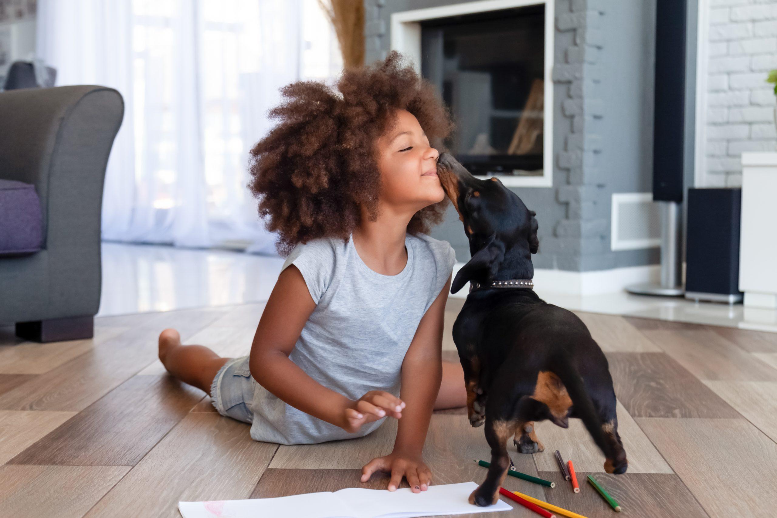 girl on floor with dog